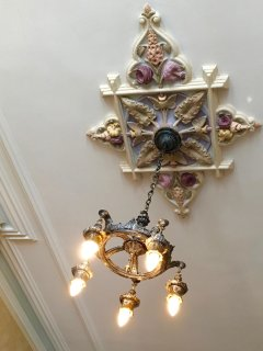 Hand painted ceiling medallions bedeck the ceilings like gems.