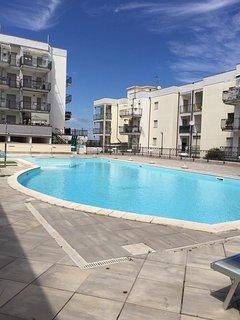 Appartamento con giardino privato in Residence con piscina