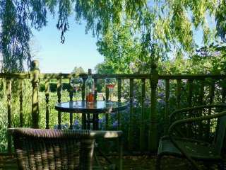 Guest's outside seating area with views to front fields. BBQ available on request. Relax, cheers!