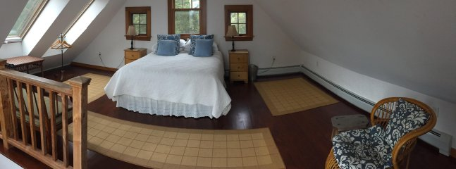 Upstairs bedroom with queen bed and access to deck