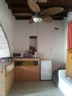kitchen area, microwave, fridge, toaster, watercooker, gascooker