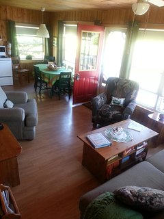 Comfortable family room with big screen TV, games, puzzles, books and iPod dock.