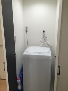 Indoor Laundry Machine. This is a photo after the re-location and renovation of the apartment.