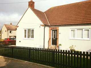 Seahouses 2 bedroom stylish bungalow with parking, large gardens & pet friendly