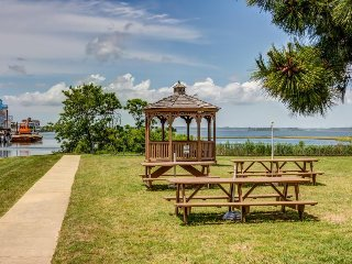 Condo w/shared pool, dock & beach access - partial bay views