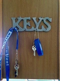 Keys on key hook on the left as you enter the kitchen.