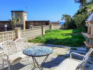 Apartamento con jardín, vistas al mar Faro de Salou