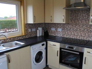 Kitchen with washing machine and dishwasher