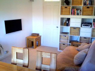 The warm and welcoming lounge/dining room with UK and French TV, DVD, Stereo, books & sofa bed for 2