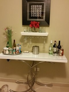 Bar with hanging glasses and other accessories.  Liquor not included
