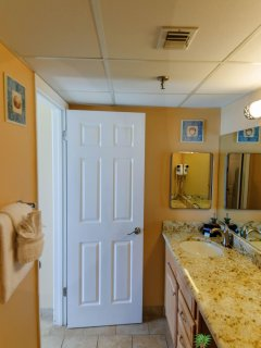 The King Neptune Suite's bathroom has a separate dressing area with a single granite topped maple vanity and lots of...