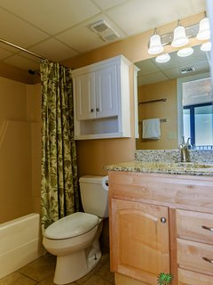 The third bathroom is just across the hall from the Crew's Quarters.  This bathroom has a tub/shower combo with shower...