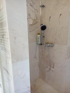 The shower of the master bathroom