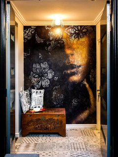 Roberta Cavelli 'Mystery Woman' wallpaper in the entry.
