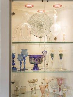 the collections of precious glasses are closed in 'vetrine' (showcase cabinets)