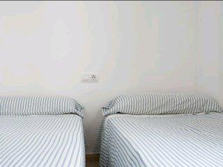 Dormitorio dos camas 90