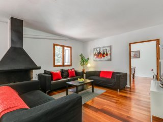 Cool downstairs lounge leads to garden, pool, games room, and dining table. has TV, Wifi
