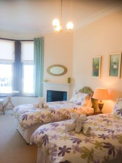 Front facing twin bedroom offering spectacular views over the harbour and Rothesay Bay