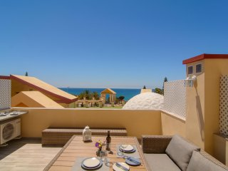 Romana Playa beachfront studio w/ terrace, WiFi shared pools and garden