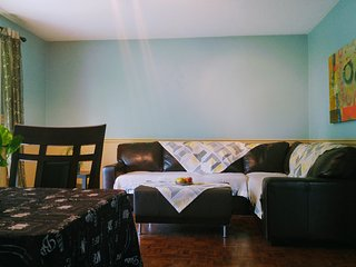 Bright 2 BR suite w/garden close to airport&bus