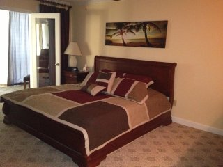 master bedroom with king sleigh and plenty of room, plus room darkening drapes for sleeping late