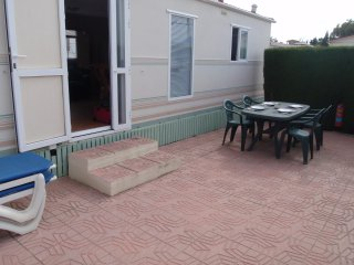 Oasis Park Albir mobile home with shared pool & nearby beach.