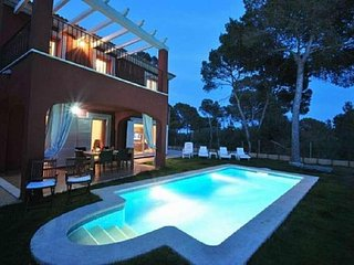 Modern twinhouse with pool and garden in Cala Pi