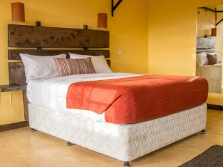 Our super comfy queen beds with custom wood headboards that you just have to sleep in to believe!