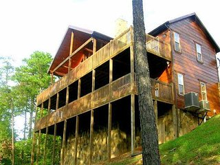 SIMPLE PLEASURES  is a luxury 2 story cabin with fully covered decks.