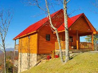 This is a bright, sunny cabin with real log cabin style, breathtaking views!!