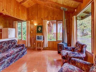 Cozy, secluded cabin w/ shared seasonal pool, wood stove & mountain views!