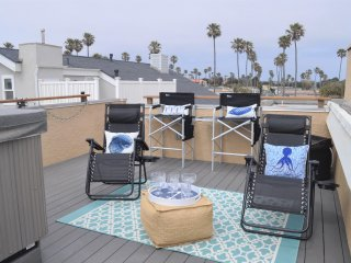 Roof top lounge area next to the hot tub. Zero-gravity and directors chairs. BPA-free stemware.