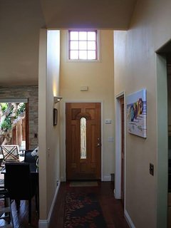 Entry area has high ceiling with lots of natural light.