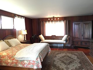 Studio with king bed, day bed and armoire in view.