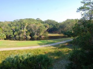 Fabulous lagoon and golf views, Yards from beach and club amenities. Secluded