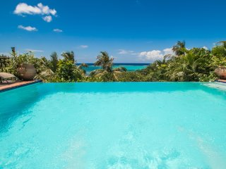 Luxurious beachfront estate with private dock, tennis court and gazebo