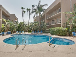 Beach-adjacent condo with shared pool offers easy access to shops, restaurants!