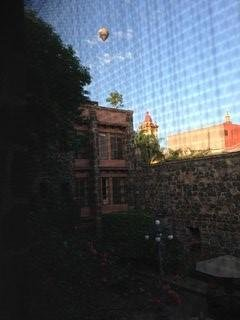Early morning view of hot air balloon through the screen in the Master Bedroom