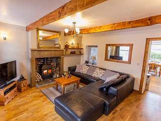 MULBERRY COTTAGE, stone-built terraced cottage, character features, woodburner,