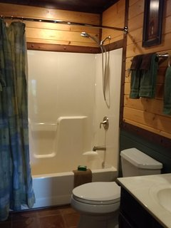 Bath/Shower combo with custom woodworking