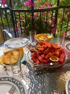 Fruit platter breakfast on your deck overlooking Laguna Bay and Little Cove.