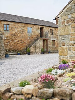 Hayloft is the first floor apartment accessed by the original stone step,