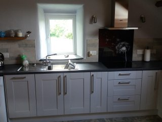 Fully fitted kitchen with view over open farmland