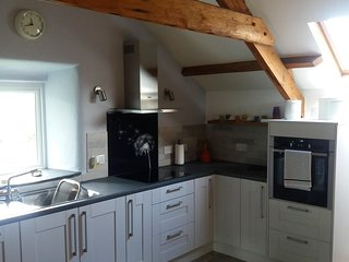 Fully fitted kitchen with dishwasher, washing machine, microwave etc