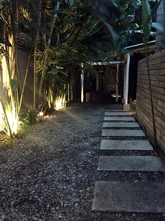 Entrance path at night.