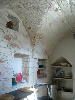 Lovely stone ceilings throughout the apartment. The kitchen is on the roof terrace level at the top