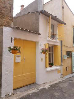 La Maison Jaune is in the old part of the village on a narrow street full of character.