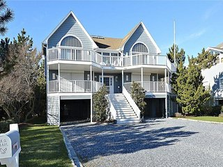 Beautiful 5 bedroom beach house with porch and hot tub!