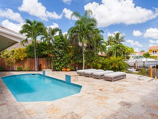 Luxury 2-story Waterfront Home With Heated Pool And Tiki Hut!