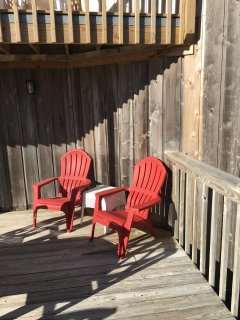large front deck with additional seating ocean, dunes, beach and lagoon views